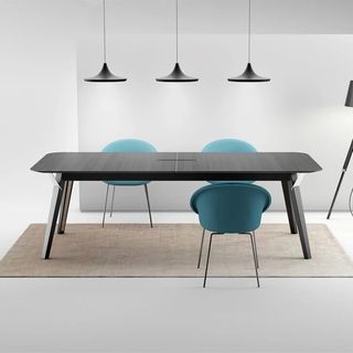 Signature table on carpet with blue chairs