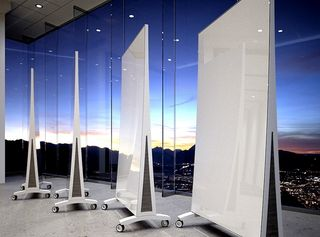 Mobile glassboards with city skyline at night in background