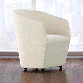 Swerve chair in white on wood floor with wheels