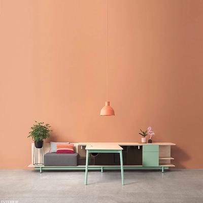 Woodstock table in orange colored room with light green accents