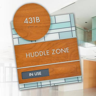 Huddle zone in use sign and office space in background