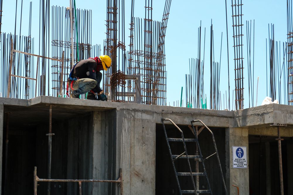 Construction Worker works with steel an concrete