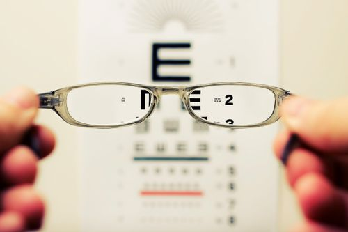 vision impaired human looking at big letters and small letters