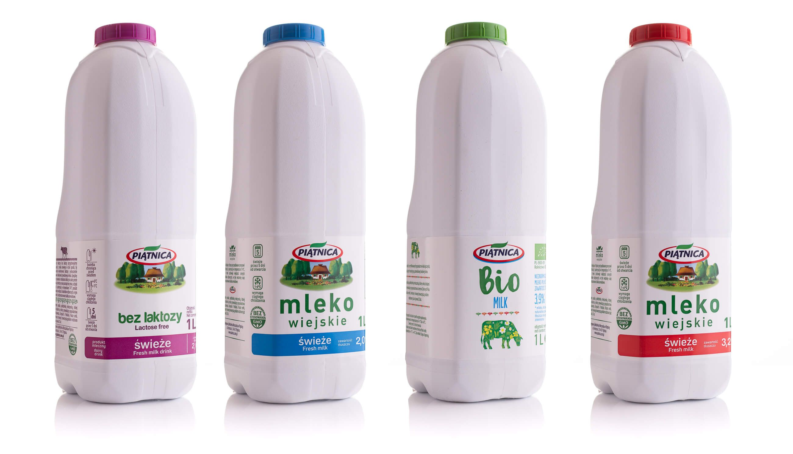 Packshot 4 różnych rodzajów butelek mleka marki Piątnica