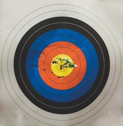 Archery target with 4 arrows in the middle