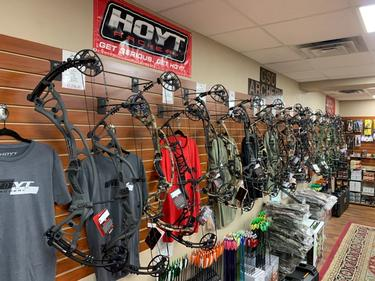 Compound bows hanging on slatwall