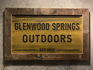 Sign outside front door that reads Glenwood Springs Outdoors