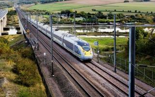 Eurostar train in rural landscape