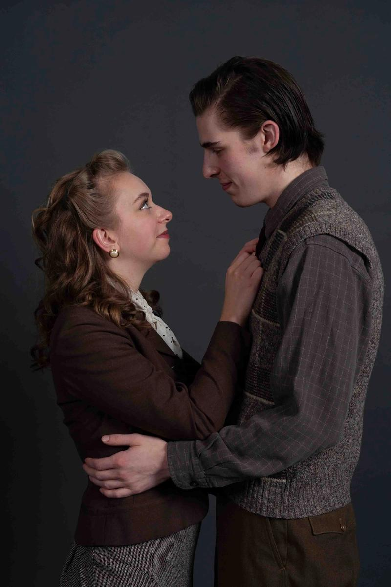 Curtis Maciborski as Raleigh and Cassie Unger as May embrace.