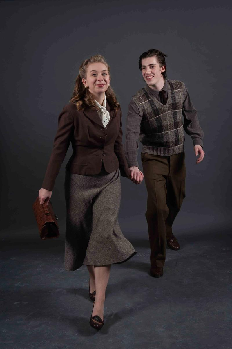 Cassie Unger as May holds Curtis Maciborski's hand as they run towards the camera.