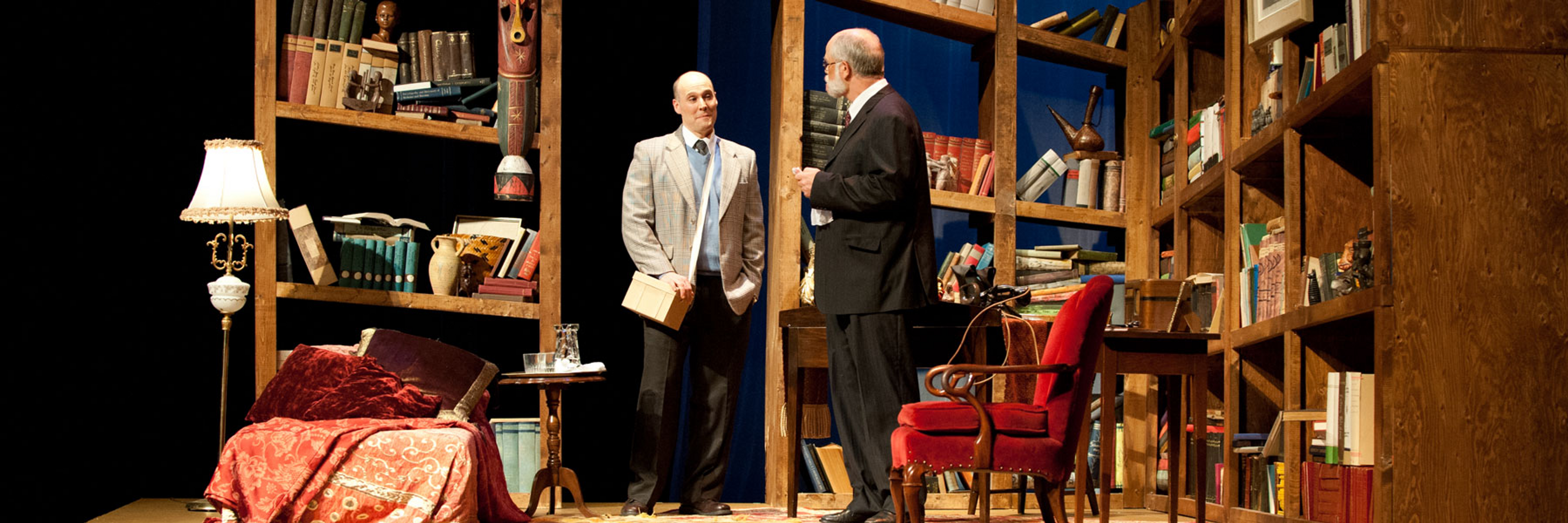 Freud's Last Session on stage, with Freud and CS Lewis standing mid-stage smiling at each other.
