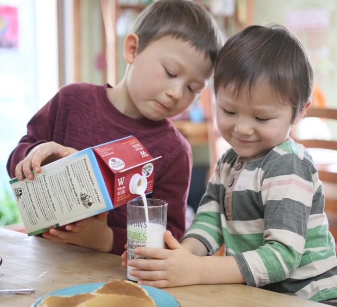 Two boys enjoying fresh Organic Valley Whole Milk.