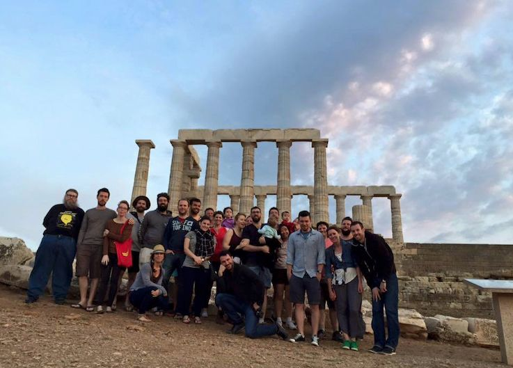 The cliniko team in Greece standing in front of some ancient ruins