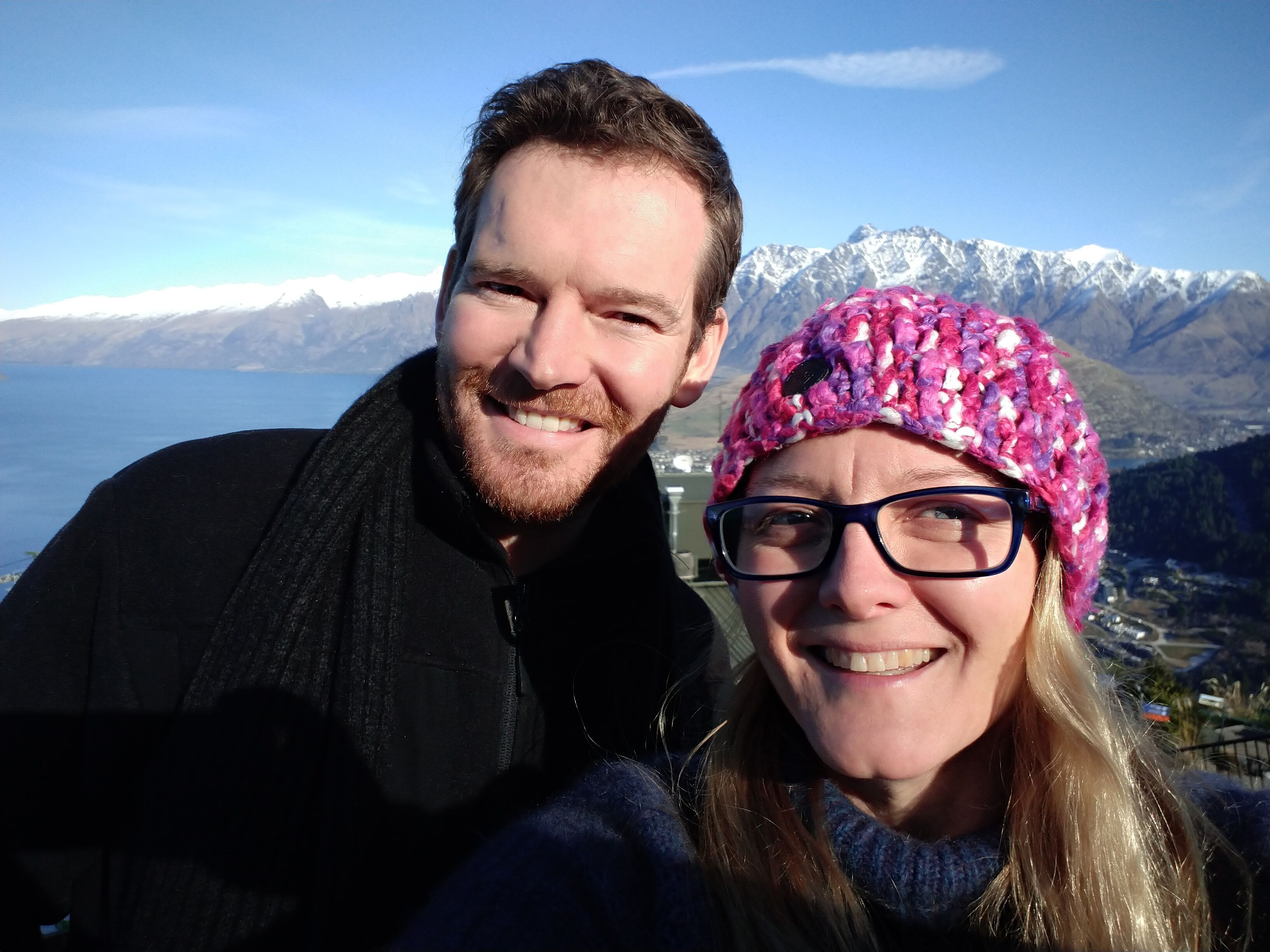 Annastashia Cambridge and Dr. Dan of Two Hands Health Ltd pictured standing in front of a snow-capped mountain range in New Zealand
