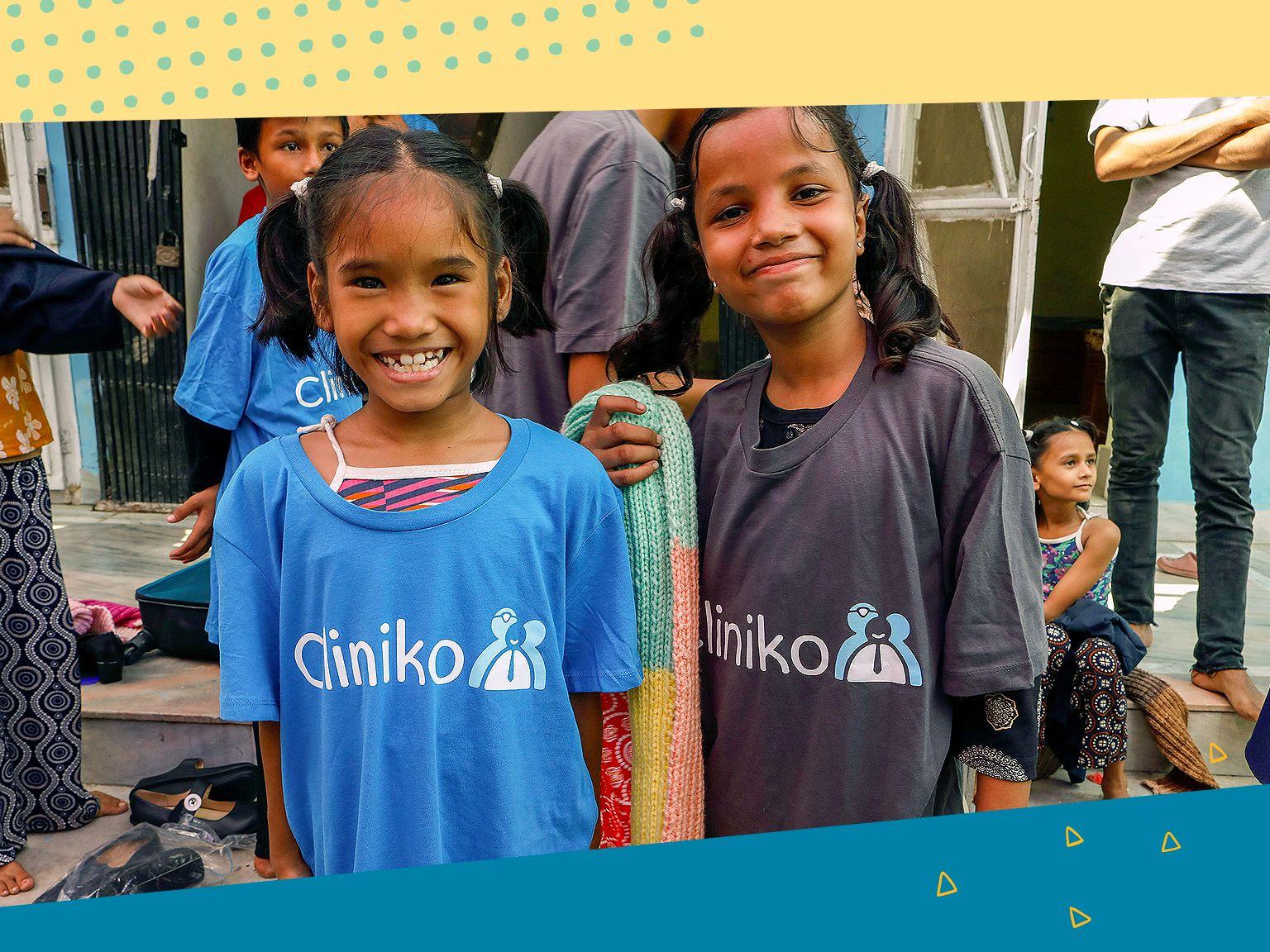 Children wearing Cliniko t-shirts