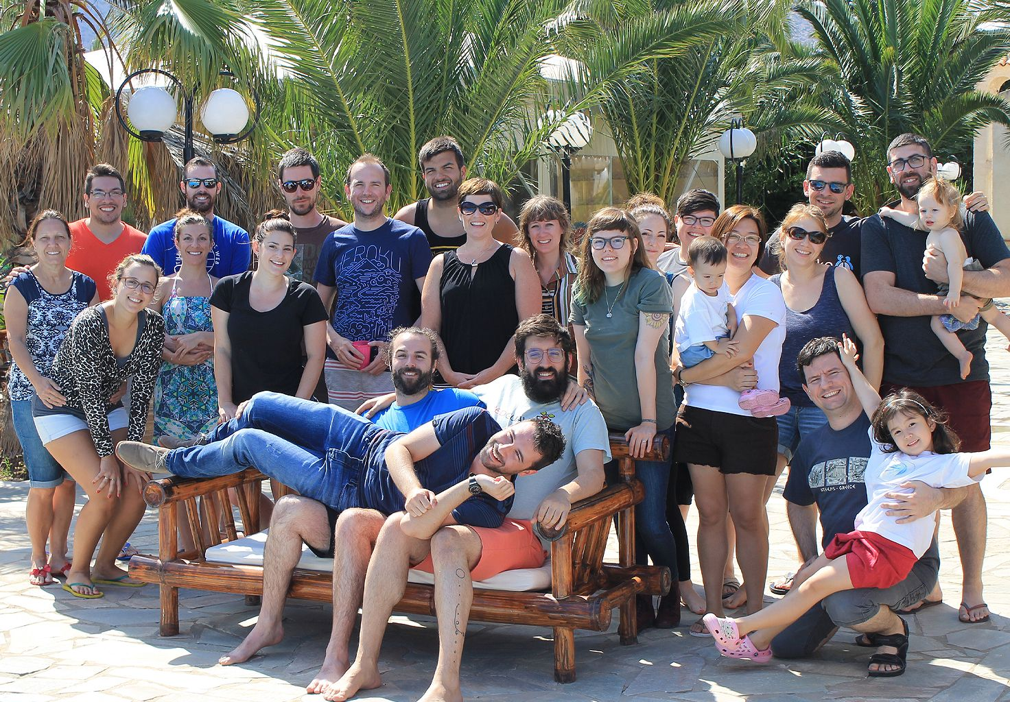 A group photo of the Cliniko team and family members in Greece.