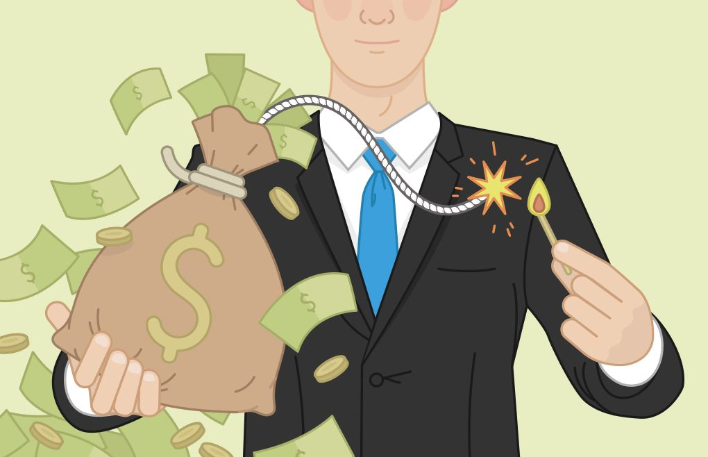 Man in a business suit lighting a fuse to a bag of money