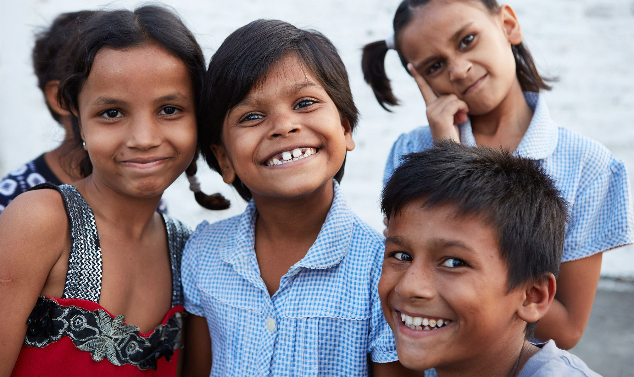 Smiling kids at a Beyond the Orphanage home