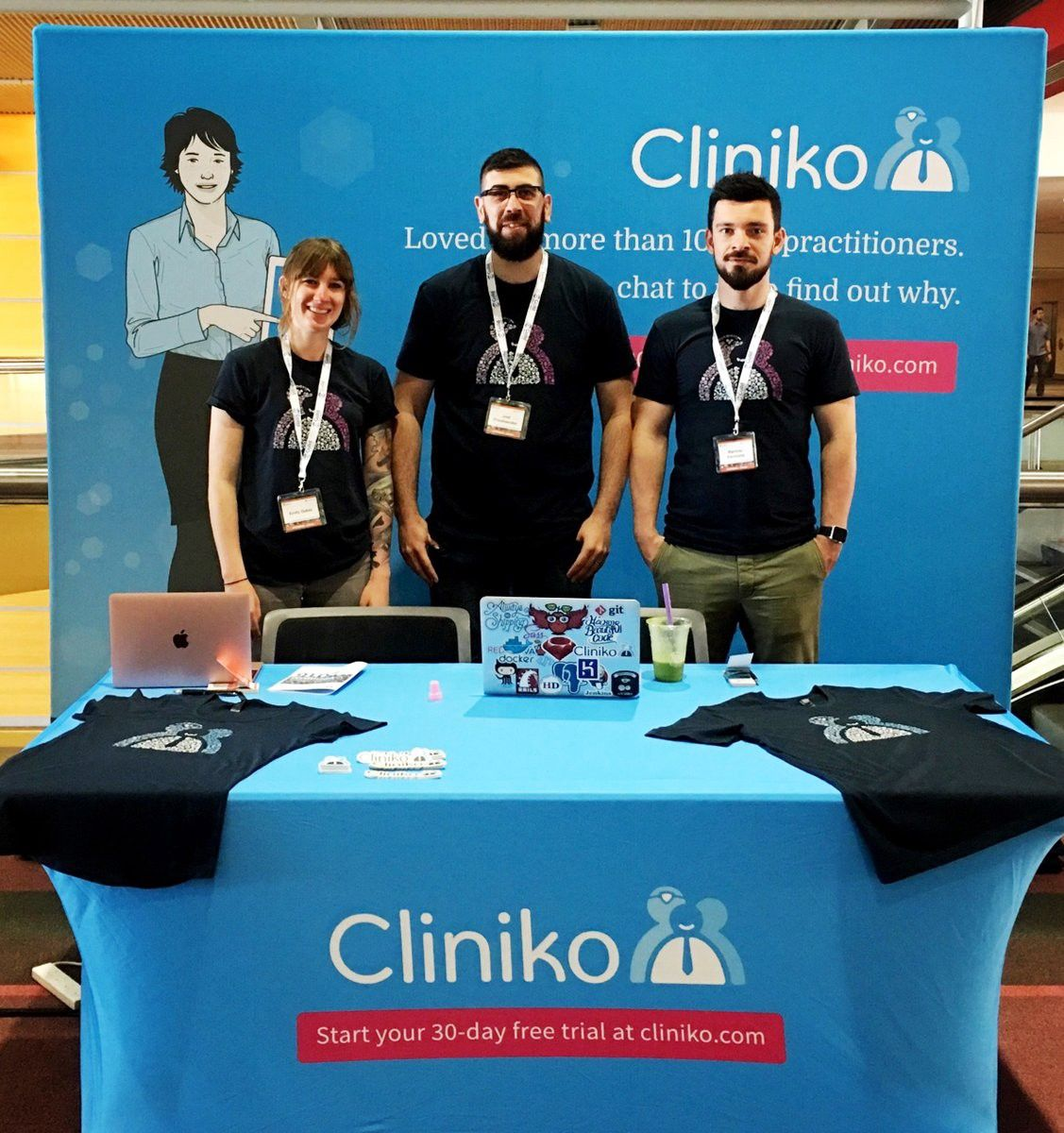 Part of the Cliniko team at a conference booth