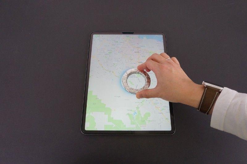 styrofoam wrapped loupe on touchscreen