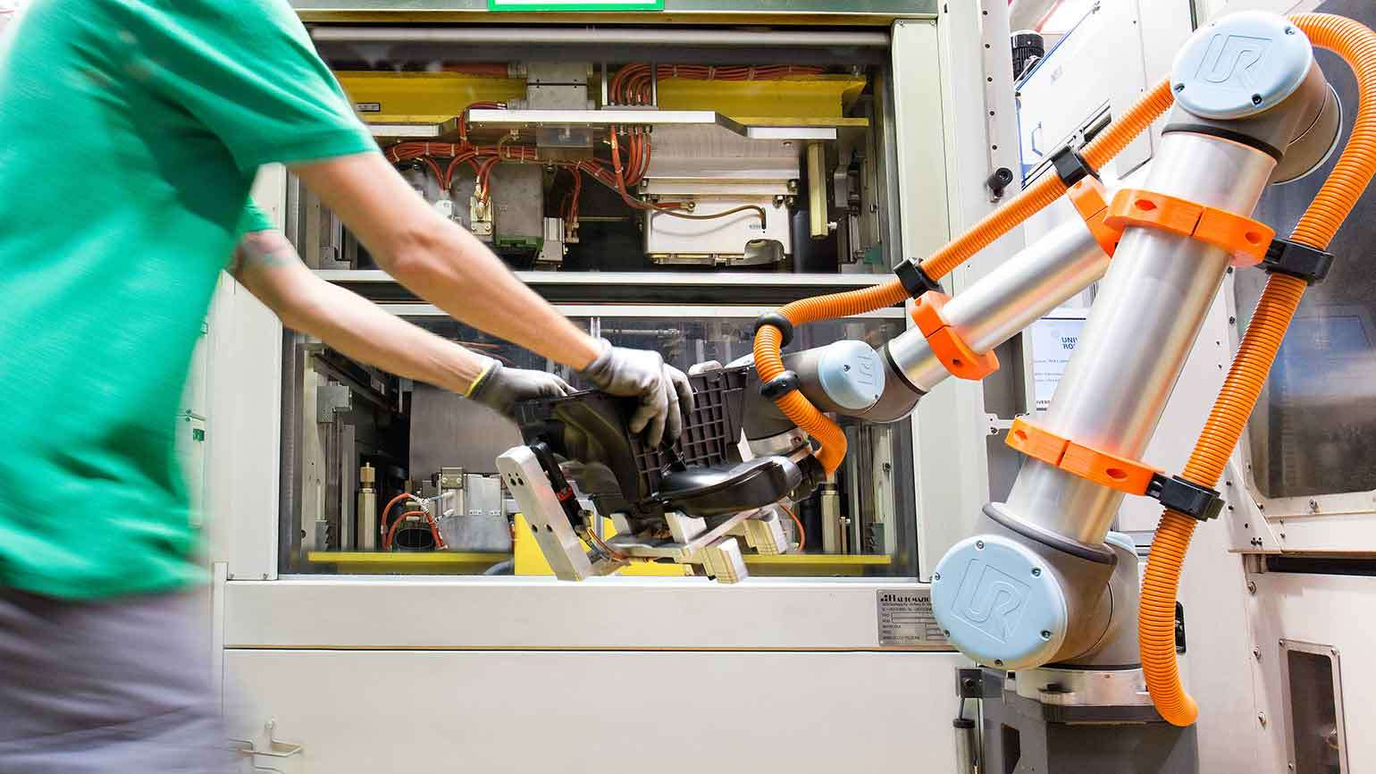 """""""Workers and collaborative robots optimizing production at MANN+HUMMEL"""" - Universal Robots via https://www.skyfish.com/"""