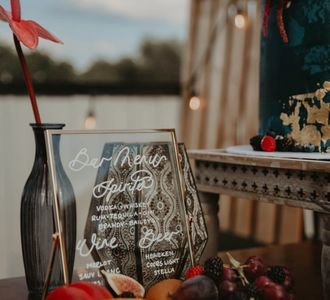 "hand lettered wedding sign that reads ""welcome""."