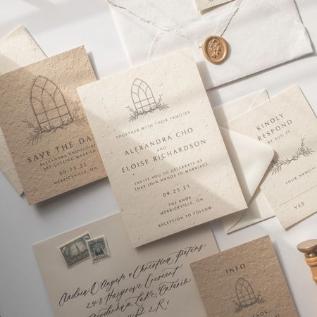 A custom designed wedding invitation with envelope and wax seal.