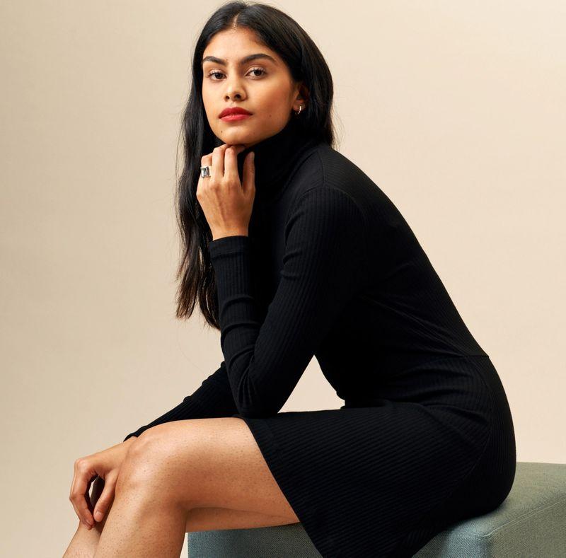 Woman wearing the Turtleneck Mini Dress in Black