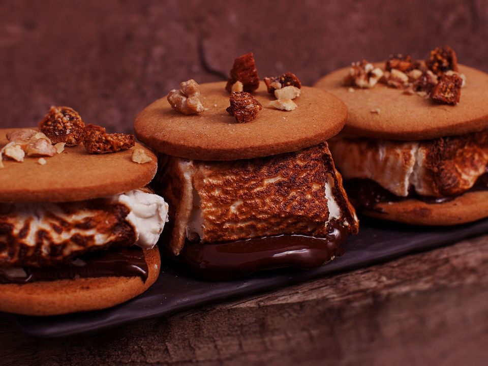 Three Krumbies s'mores: sticky-sweet marshmallows and chocolate toasted to gooey perfection and sandwiched between two biscuits.