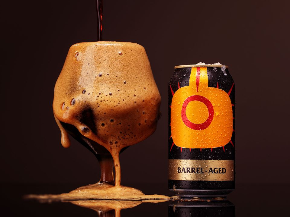 A can and an overflowing glass of Moo Brew's barrel-aged stout.
