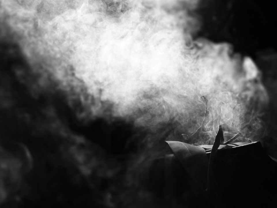 Smoke rises in the darkness.