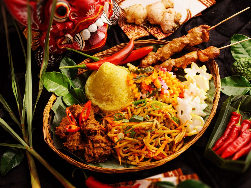 Fresh-fried rice served with chicken skewers and fresh chilli.
