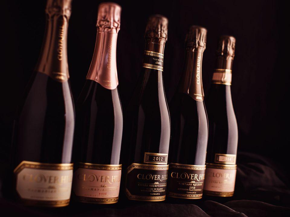 Five bottles of Clover Hill sparkling wine.