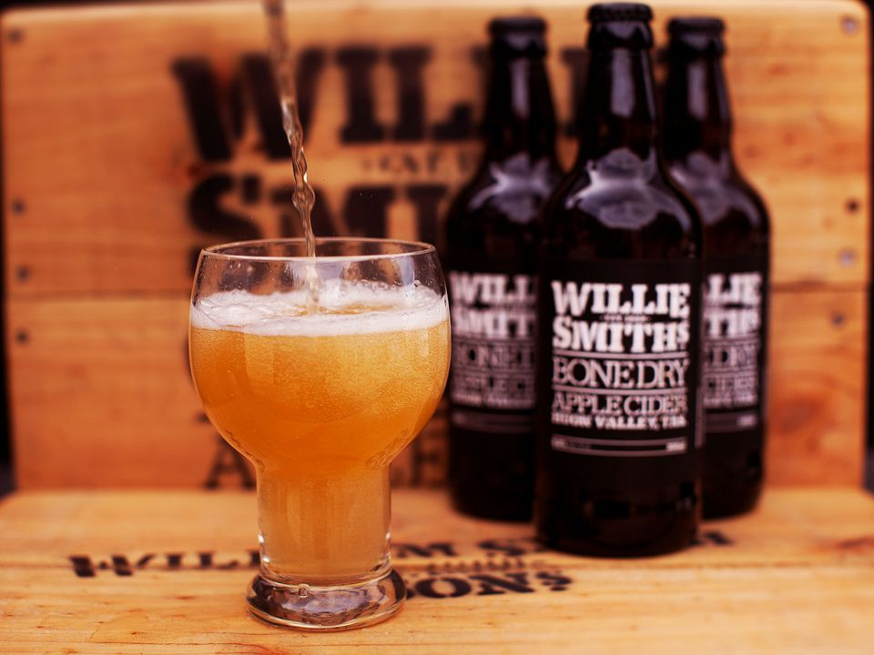 Willie Smith's Bone Dry Apple Cider being poured into a glass.
