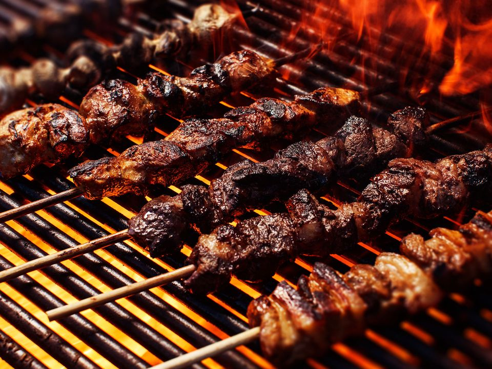 Kebabs roasting on the grill.