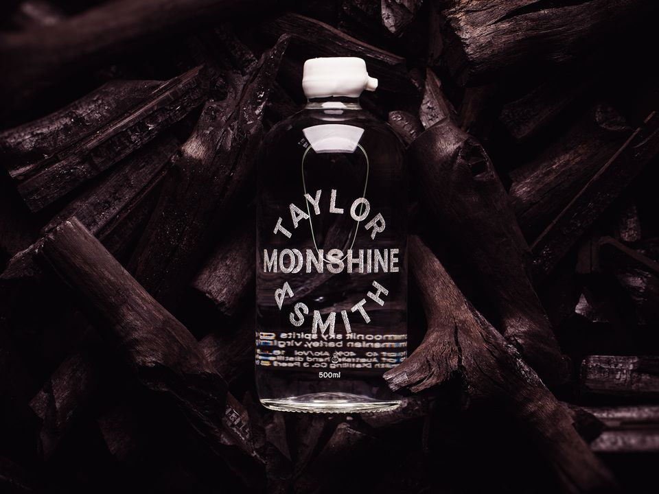 A bottle of Taylor & Smith Moonshine.
