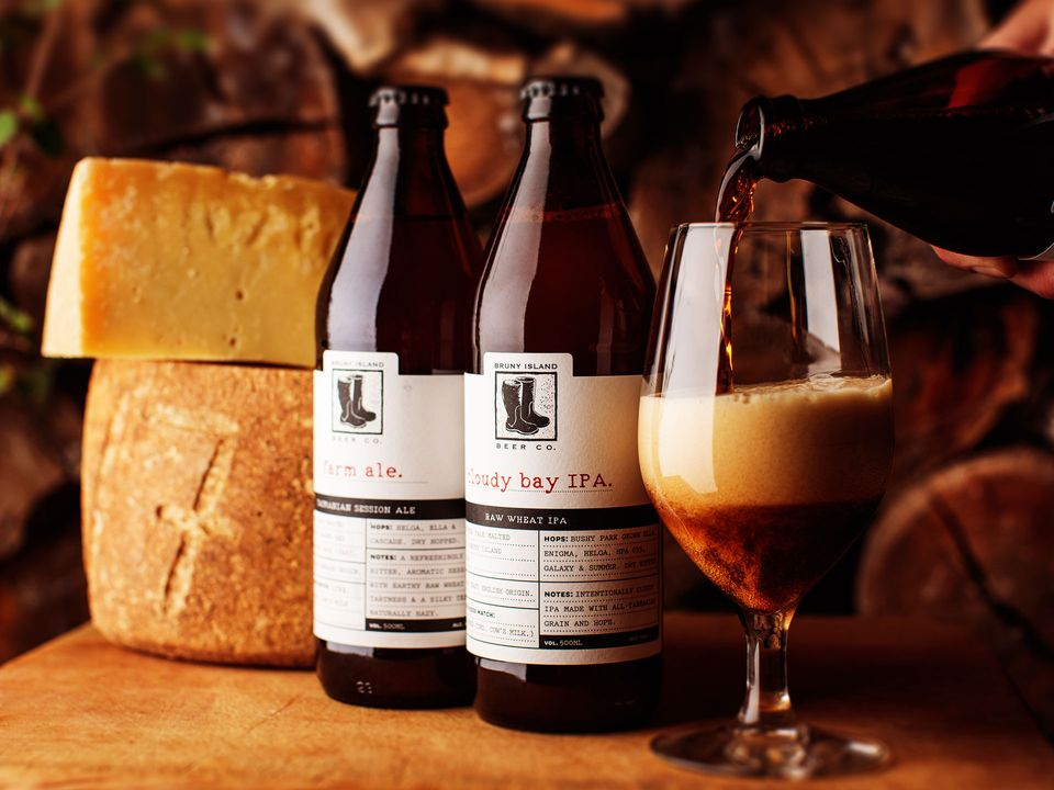 Two bottles and a glass of Bruny Island Cheese Co.'s IPA.