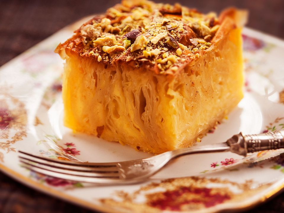 A serving of Persian soufra: complex, folded layers of filo pastry and custard, topped with pistachios.