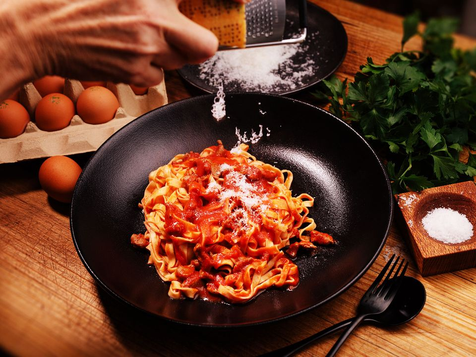 Lamb ragù fettucine topped with grated parmesan cheese.