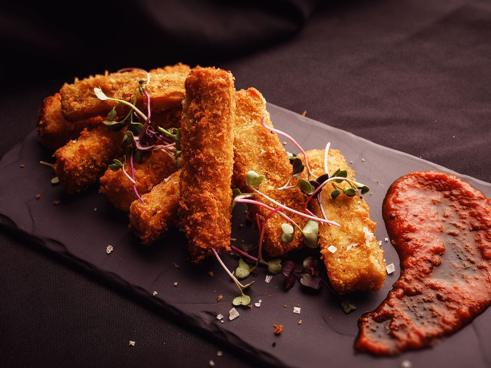 A stack of dairy-free panko-crumbed mac and cheese sticks.
