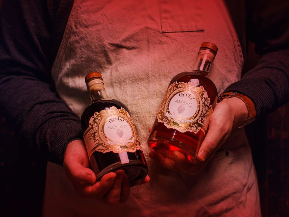Two bottles of Stefano Lubiana liqueur.