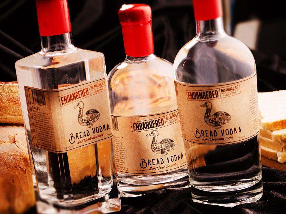 Three bottles of Endangered Distilling Co.'s bread vodka.