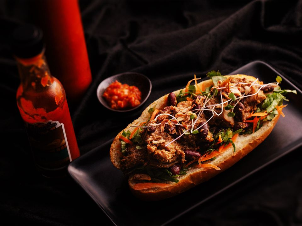 A Rendang sandwich served with fresh chilli.