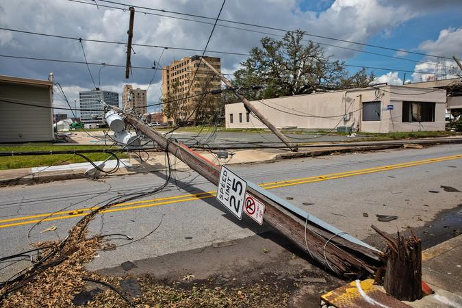 Hurricane Laura's 150-mph winds snapped utility poles down in Lake Charles. Photo: Julie Dermansky.