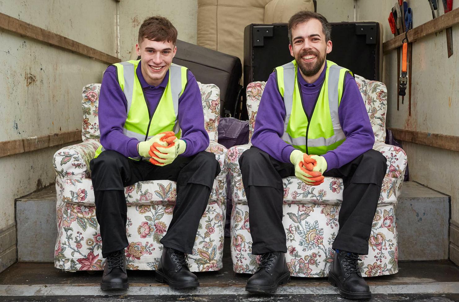 waste operatives in a removal van