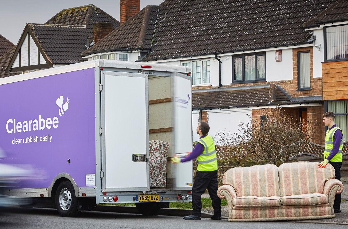 operatives loading sofa onto a van