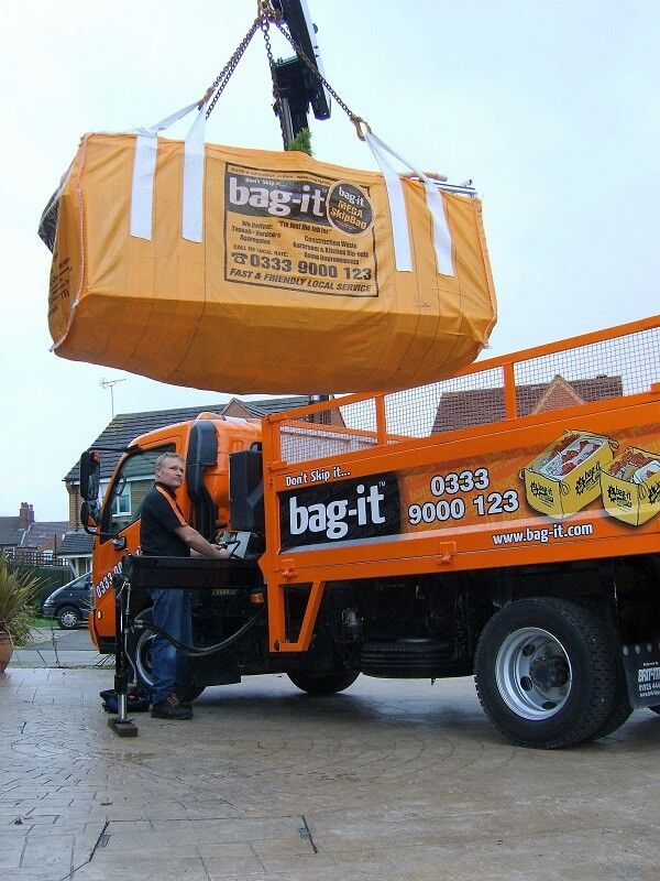 Skip Bag being suspended by a crane