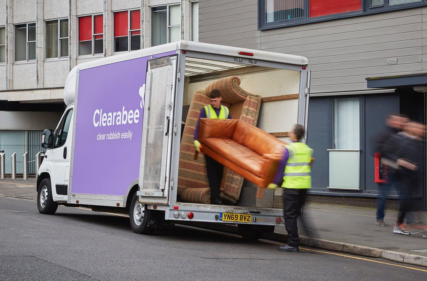 sofa loaded into a van