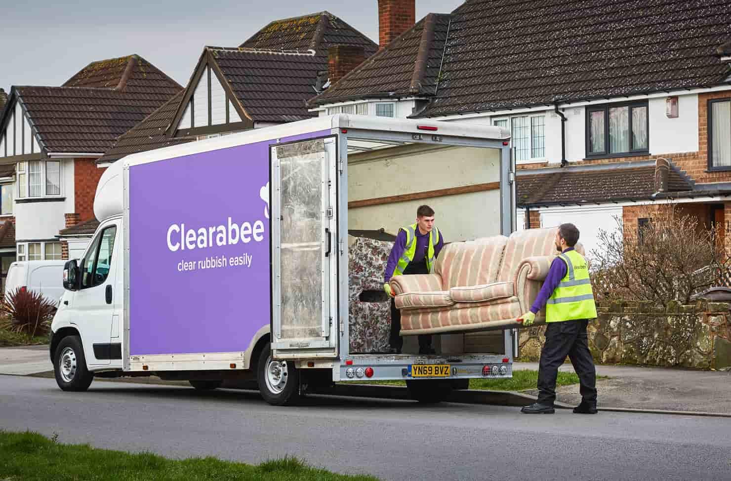 operatives loading a sofa onto a van