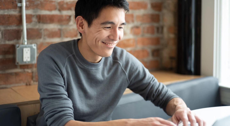 Yuhki Yamashita, VP of Product at Figma, working at the Figma office